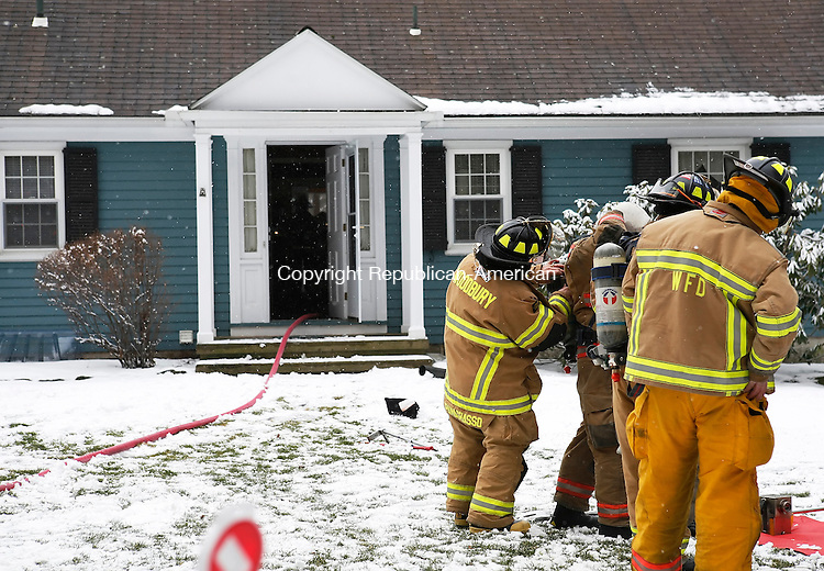 Woodbury, CT-10, February 2010-021010CM14   Woodbury Volunteer Firefighters begin to clear out and inspect gear outside the residence at 124 Old Sherman Hill Road in Woodbury Wednesday afternoon.  The fire department was called to the residence after a report of a fire.    --Christopher Massa Republican-American