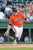 First baseman Jon McGibbon (12) of the Clemson Tigers bats in a game against the Furman Paladins on Wednesday, May 8, 2013, at Fluor Field at the West End in Greenville, South Carolina. (Tom Priddy/Four Seam Images)