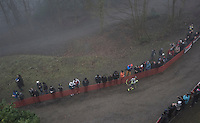 Gioele Bertolini (ITA/U23) running loney (& last) up a hill after crashing at the start of the Men's U23 race<br /> <br /> UCI Cyclocross World Cup Namur/Belgium 2016