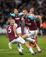 Andy Carroll of West Ham United turns to celebrate his goal during the Premier League match between West Ham United and Stoke City at the Olympic Park, London, England on 16 April 2018. Photo by Andy Rowland.