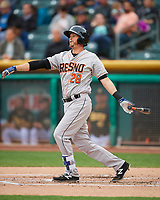 Reid Brignac (28) of the Fresno Grizzlies follows through on his swing against the Salt Lake Bees during the Pacific Coast League game at Smith's Ballpark on April 17, 2017 in Salt Lake City, Utah. The Bees defeated the Grizzlies 6-2. (Stephen Smith/Four Seam Images)
