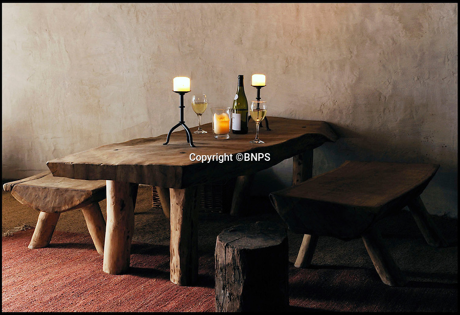 BNPS.co.uk (01202 558833)<br /> Pic: UpcottRoundhouse/BNPS<br /> <br /> Yabba-dabba-doo...<br /> <br /> Hand made furniture...Iron age style.<br /> <br /> A farmer has painstakingly recreated an Iron Age roundhouse to enable holidaymakers to release their inner Flintstone in the heart of the Devon countryside.<br /> <br /> Charles Cole has gone back over 2000 years to offer a back to basic's experience including a stone hearth fire, rudimentary plumbing, composting toilet and a six ton thatched roof to keep out the wind and rain.<br /> <br /> The amazing structure has been completely hand built by Charles and his family from materials sourced from their own farm and they have just opened up for bookings at £170 a night..animal skins are optional.