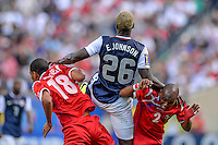Chicago, IL - Sunday July 28, 2013:   USMNT forward Eddie Johnson (26) battles for an air ball during the CONCACAF Gold Cup Finals soccer match between the USMNT and Panama, at Soldier Field in Chicago, IL.