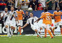 CARSON, CA - DECEMBER 01, 2012:   Todd Dunivant (2) of the Los Angeles Galaxy tries to block a shot from Corey Ashe (26) of the Houston Dynamo during the 2012 MLS Cup at the Home Depot Center, in Carson, California on December 01, 2012. The Galaxy won 3-1.
