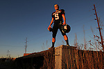 West De Pere High School quarterback Jay Tollefso is shown on an abandoned railroad structure in De Pere. Tollefson won back to back state championships with the Phantoms in 2010 and 2011.