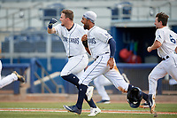 Charlotte Stone Crabs Carl Chester (left) and Garrett Whitley (16) celebrate a walk-off win during a Florida State League game against the Dunedin Blue Jays on April 17, 2019 at Charlotte Sports Park in Port Charlotte, Florida.  Charlotte defeated Dunedin 4-3.  (Mike Janes/Four Seam Images)