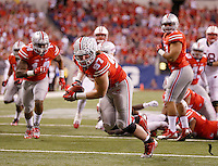 Ohio State Buckeyes defensive lineman Joey Bosa (97) picks up a fumble for a touchdown in the second quarter of the Big Ten Championship game at Lucas Oil Stadium in Indianapolis on Saturday, December 6, 2014. (Columbus Dispatch photo by Jonathan Quilter)
