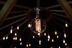 Lightbulbs glow inside the Levi's Makers yurt in Brooklyn.