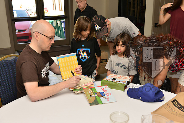 "CORAL GABLES, FL - JANUARY 09: Author Brad Meltzer sign copy of his ""I Am Martin Luther King, Jr."" at  The Family Day Block Party first annual block party with activity in Coral Gables art Cinema and Coral Gables Museum presented by Books and Books at Aragon Avenue in Coral Gables on Saturday January 9, 2016 in Coral Gables, Florida.  ( Photo by Johnny Louis / jlnphotography.com )"