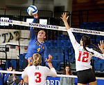 BROOKINGS, SD - SEPTEMBER 4:  Ashlynn Smith #4 from South Dakota State tips the ball past Kathryn Graf #12 and Erica Haslag #3 from Bradley in their match Sunday afternoon at Frost Arena in Brookings. (Photo by Dave Eggen/Inertia)