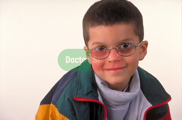portrait of smiling young boy wearing glasses