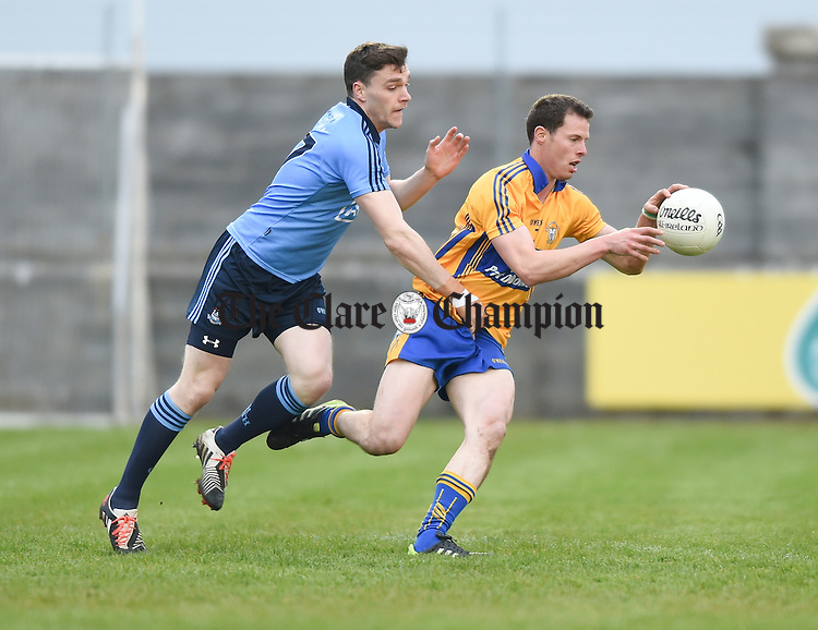 Jack Mc Caffrey of Dublin in action against Kevin Hartnett of Clare during their game as part of the official switching on of the new floodlighting at Hennessy park, Miltown Malbay. Photograph by John Kelly.