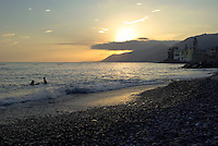 Tramonto alla spiaggia del paese Camogli (Liguria) --- Sunset on the beach at the village Camogli (Liguria)