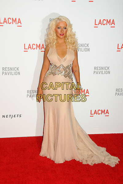"CHRISTINA AGUILERA .at LACMA's ""The Unmasking"" The Lynda & Stewart Resnick Exhibition Pavilion Opening Gala at The Los Angeles County Museum of Art in Los Angeles, California, USA, September 25th 2010..full length long maxi dress gown train clutch bag  beige nude halterneck silk chiffon silver tattoo   bracelet         .CAP/ADM/BP.©Byron Purvis/AdMedia/Capital Pictures."