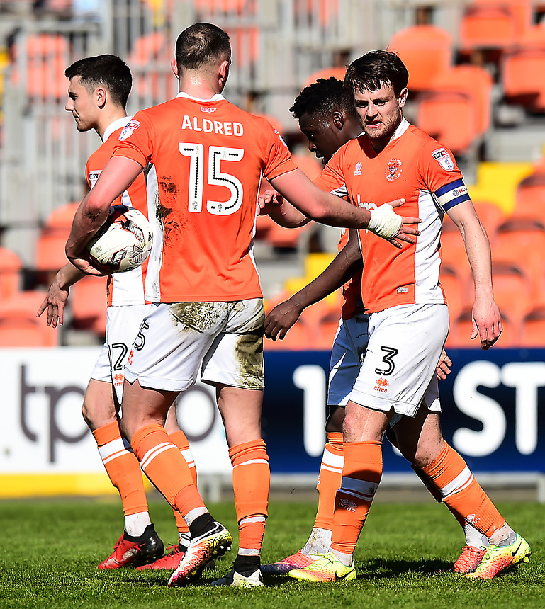 Blackpool's Andy Taylor celebrates with his team-mates after Grimsby Town scored an own goal<br /> <br /> Photographer Richard Martin-Roberts/CameraSport<br /> <br /> The EFL Sky Bet League Two - Blackpool v Grimsby Town - Saturday 8th April 2017 - Bloomfield Road - Blackpool<br /> <br /> World Copyright &copy; 2017 CameraSport. All rights reserved. 43 Linden Ave. Countesthorpe. Leicester. England. LE8 5PG - Tel: +44 (0) 116 277 4147 - admin@camerasport.com - www.camerasport.com