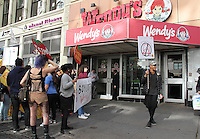 NEW YORK, NY - OCTOBER 15:  Farmworkers and sttudents hold protest outside of Wendy's in Union Square in support of a national boycott of the fast food chain in New York, New York on October 15, 2016.  Photo Credit: Rainmaker Photo/MediaPunch