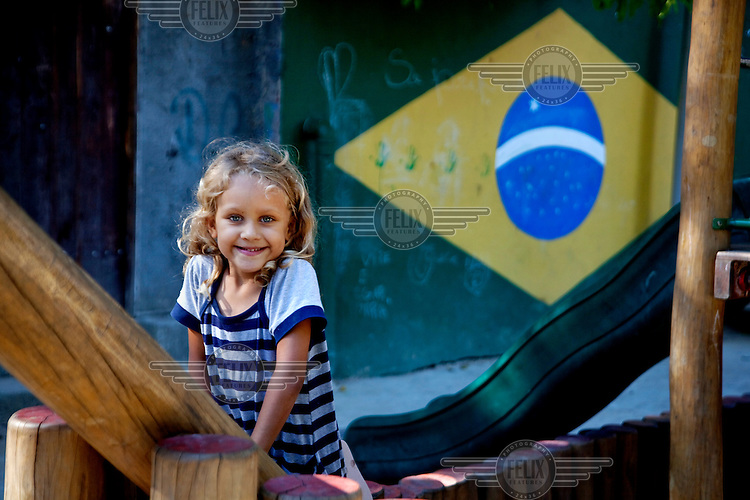 A girl enjoys herself in a newly constructed playground, part of the Morar Carioca urbanising project, in the Morro da Babilonia favela.