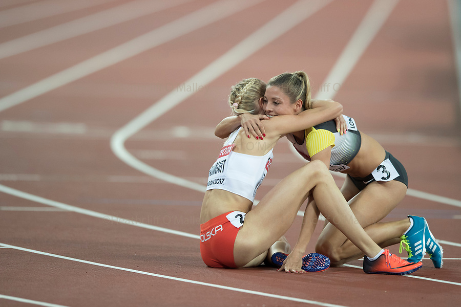 Mcc0078114 . Daily Telegraph<br /> <br /> DT Sport<br /> <br /> Iga Baumgart and and Ruth Spelmeyer hug at the end of the Women's 400m semi final<br /> <br /> Day 4 of the IAAF World Championships at the London Stadium in Stratford .<br /> <br /> 6 August 2017