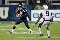 6 November 2010:  FIU wide receiver Wayne Times (5) attempts to evade Louisiana-Monroe cornerback Otis Peterson (9) after a reception in the second quarter as the FIU Golden Panthers defeated the University of Louisiana-Monroe Warhawks, 42-35 in double overtime, at FIU Stadium in Miami, Florida.
