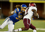 BROOKINGS, SD - OCTOBER 7: Eric Kleinschmit #31 from South Dakota State University closes in to bring down Darrell James #8 from Southern Illinois in the first half of their game Saturday night at Dana J. Dykhouse Stadium in Brookings. (Photo by Dave Eggen/Inertia)