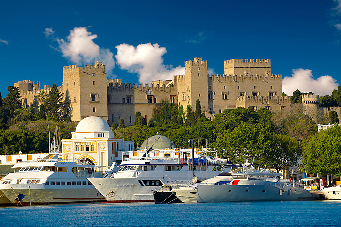 The 14th century medieval palace of the Grand Master of the Kinights of St John with the archaic harbour below, Rhodes, Greece. UNESCO World Heritage Site