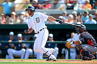 Detroit Tigers shortstop Jhonny Peralta #27 at bat in front of catcher Gerald Laird #11 during a Spring Training game against the Atlanta Braves at Joker Marchant Stadium on February 27, 2013 in Lakeland, Florida.  Atlanta defeated Detroit 5-3.  (Mike Janes/Four Seam Images)