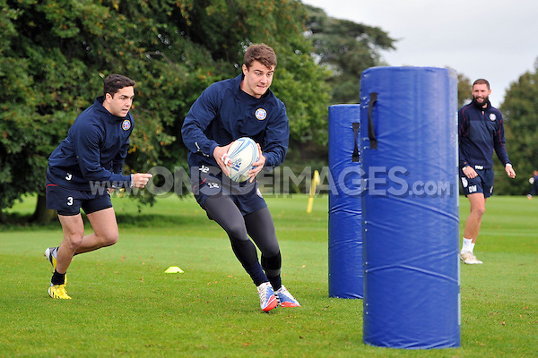 Ollie Devoto with the ball. Bath Rugby training session on October 17, 2013 at Farleigh House in Bath, England. Photo by: Patrick Khachfe/Onside Images