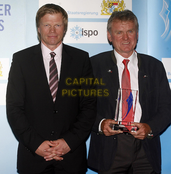 OLIVER KAHN & SEPP MAIER.Bavarian Sport Award Prize 2009, Munich ICM, Neue Messe, Germany..June 29th, 2009.half length black suit jacket red tie trophy.CAP/PPG/TF.©T. Furthmayr/People Picture/Capital Pictures