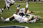 UC Davis quarterback Ben Scott dives in to the endzone for a touchdown during the final seconds of an NCAA college football game against Nevada in Reno, Nev. on Thursday, Sept. 3, 2015. Nevada won 31-17. (AP Photo/Cathleen Allison)