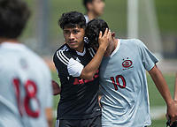 NWA Democrat-Gazette/BEN GOFF @NWABENGOFF<br /> Luis Paredes (11) of Fort Smith Northside embraces Jose Vega (10) of Springdale after Fort Smith Northside defeated Springdale 2-1 Saturday, May 12, 2018 during the semifinal match in the boys 7A state soccer tournament in Gates Stadium at Rogers Heritage.