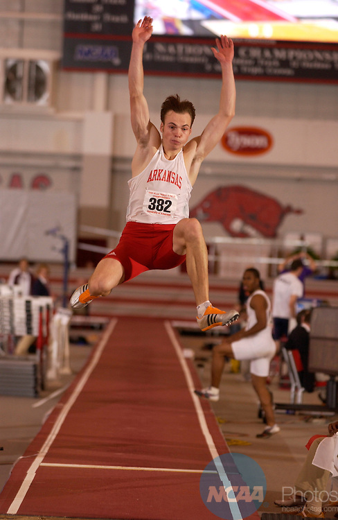 11 MAR 2006: Arkansas Jaanus Uudmae competes in the Men's Tripple Jump Saturday evening at the 2006 NCAA Div I National Indoor Track and Field Championships held at the Randel Tyson Track Complex on the Univeristy of Arkansas Campus in Fayetteville, Ark.   Arkansas won the championship title with 53 points.  Tom Ewart/NCAA Photos
