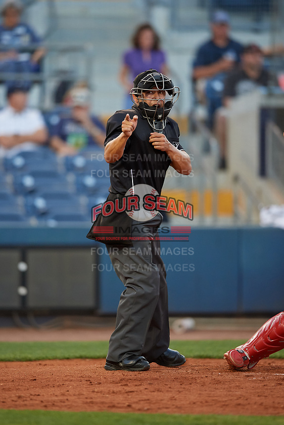 Home plate umpire Jhonatan Biarreta calls a strike during a game between the Palm Beach Cardinals and the Charlotte Stone Crabs on April 20, 2018 at Charlotte Sports Park in Port Charlotte, Florida.  Charlotte defeated Palm Beach 4-3.  (Mike Janes/Four Seam Images)