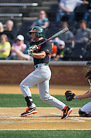 George Iskenderian (7) of the Miami Hurricanes follows through on his swing against the Wake Forest Demon Deacons at Wake Forest Baseball Park on March 21, 2015 in Winston-Salem, North Carolina.  The Hurricanes defeated the Demon Deacons 12-7.  (Brian Westerholt/Four Seam Images)