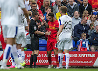 Danny Ings of Liverpool  speaks to Referee Paul Hodskinson after a clash with Mitch Duggan of Tranmere Rovers causes a nasty cut during the 2016/17 Pre Season Friendly match between Tranmere Rovers and Liverpool at Prenton Park, Birkenhead, England on 8 July 2016. Photo by PRiME Media Images.