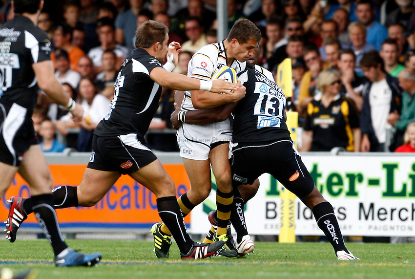 Photo: Richard Lane/Richard Lane Photography. Exeter Chiefs v London Wasps. Aviva Premiership. 25/09/2011. Wasps' Jack Wallace is tackled by Exeter's Sireli Naqelevuki.