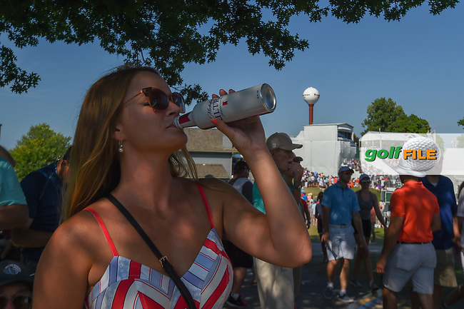 An avid golf fan sips on a cold beverage to stay cool near the green on 16 during 3rd round of the World Golf Championships - Bridgestone Invitational, at the Firestone Country Club, Akron, Ohio. 8/4/2018.<br /> Picture: Golffile | Ken Murray<br /> <br /> <br /> All photo usage must carry mandatory copyright credit (© Golffile | Ken Murray)