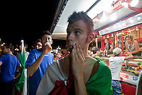 01/07/2012 Finale dei campionati europei di calcio 2012  Italia - Spagna: delusione dei tifosi in piazza a Torino. Tifosi tristi dopo la partita vicino ad un camion dei panini.