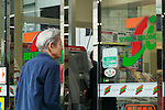 A man enters to the 7-Eleven convenience store on April 11, 2016, Tokyo, Japan. Toshifumi Suzuki, Seven iHoldings Co. chairman and CEO abruptly announced his resignation at a news conference on Thursday after the company board rejected his proposal to replace Ryuichi Isaka, president of 7-Eleven Japan. Isaka was considered to be a potential future successor to Suzuki at the head of the retail group and it was rumored that Suzuki was trying remove Isaka in order to pave the way for his son to take over in the future. (Photo by Rodrigo Reyes Marin/AFLO)