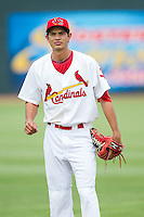Carlos Torres (21) of the Johnson City Cardinals warms up in the outfield prior to the game against the Elizabethton Twins at Cardinal Park on July 27, 2014 in Johnson City, Tennessee.  The game was suspended in the top of the 5th inning with the Twins leading the Cardinals 7-6.  (Brian Westerholt/Four Seam Images)