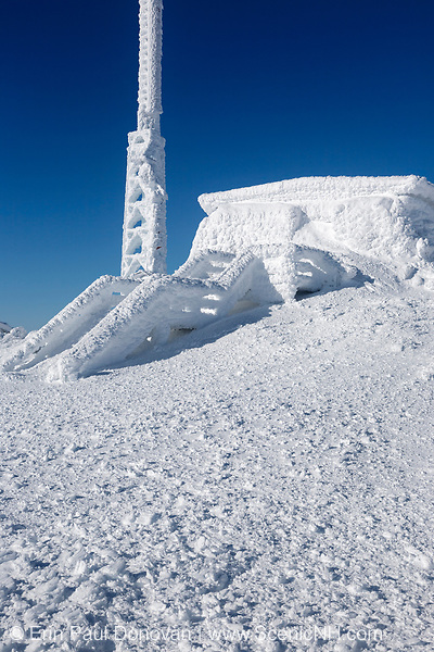 The stairs to the Tip Top House on the summit of Mount Washington in the White Mountains, New Hampshire covered in snow during the winter months.