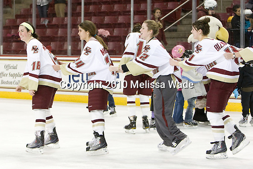 Ashley Motherwell (BC - 18) leads the line of skaters - Meagan Mangene (BC - 24), Kiera Kingston (BC - 32), Melissa Bizzari (BC - 4) - The Boston College Eagles women's team hosted a fan skate following their victory over Harvard on Sunday, December 5, 2010, at Conte Forum in Chestnut Hill, Massachusetts.