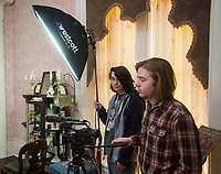NWA Democrat-Gazette/BEN GOFF @NWABENGOFF<br /> Tate Abbott secures a light stand as Joseph Caster operates a camera for an interview Friday, March 2, 2018, as students from Arkansas Arts Academy film for a project at the Peel Mansion Museum and Heritage Gardens in Bentonville. High school students from the school's audio visual class and theater program are collaborating to produce a 15 minute short film about the Peel Mansion as an entry for the Arkansas Educational Television Network's Student Selects competition for young filmmakers. The film includes interviews with people involved in the museum as well as vignettes of moments in the 1875 home's history with theater students portraying historical figures.
