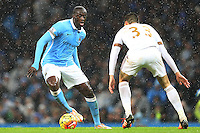 Yaya Toure competes with Frederico Fernandez during the Barclays Premier League Match between Manchester City and Swansea City played at the Etihad Stadium, Manchester on 12th December 2015