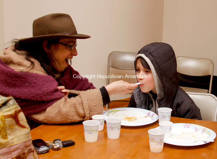 WASHINGTON, CT-17 FEBRUARY 2012 021712JW07 - Judy Apicella of New Milford and her son Nico Apicella age 8 enjoy some pancakes with maple syrup supplied by the Washington's Institute for American Indian Studies during the Institute's Maple Sugaring event Saturday morning..Jonathan Wilcox Republican American..