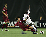 08 July 2007: Portugal's Nuno Coelho (6) challenges Gambia's Paul Jatta (8) for the ball. Gambia's Under-20 Men's National Team defeated Portugal's Under-20 Men's National Team 2-1 in a Group C opening round match at Olympix Stadium in Montreal, Quebec, Canada during the FIFA U-20 World Cup Canada 2007 tournament.