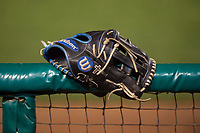 A Los Angeles Dodgers baseball glove rests on the fence during a Minor League Spring Training game against the Seattle Mariners at Camelback Ranch on March 28, 2018 in Glendale, Arizona. (Zachary Lucy/Four Seam Images)