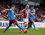 Harry Toffolo and Josh Morris of Scunthorpe Utd try to contain Mark Duffy of Sheffield Utd during the English League One match at Glanford Park Stadium, Scunthorpe. Picture date: September 24th, 2016. Pic Simon Bellis/Sportimage