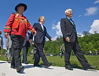 "Max ""One Onti"" Gros-Louis, Grand-Chief of the Huron-Wendate nation (left), Quebec Premier Jean Charest, center, and Jacques Langlois, President and General Director of the Commission de la capitale Nationale, walk on the newly inaugurated Promenade Samuel-de-Champlain Tuesday June 24, 2008 in Quebec City. The Promenade, a 2.5km parkway along the St-Lawrence River, is the gift from the government of Quebec to Quebec city for her 400th's birthday<br /> <br /> PHOTO :  Francis Vachon - Agence Quebec Presse"