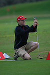 Padraig Harrington's caddy Ronan Flood takes pictures of him after he was forced to take to the Practice Range for the rest of the tournament during Day 2 Friday of the Abu Dhabi HSBC Golf Championship, 21st January 2011..(Picture Eoin Clarke/www.golffile.ie)