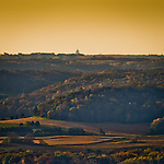 The Capitol building in Madison, Wisconsin sits atop the horizon as seen from 20 miles away at the top of Wawanissee Point, the highest point in the Baraboo Hills